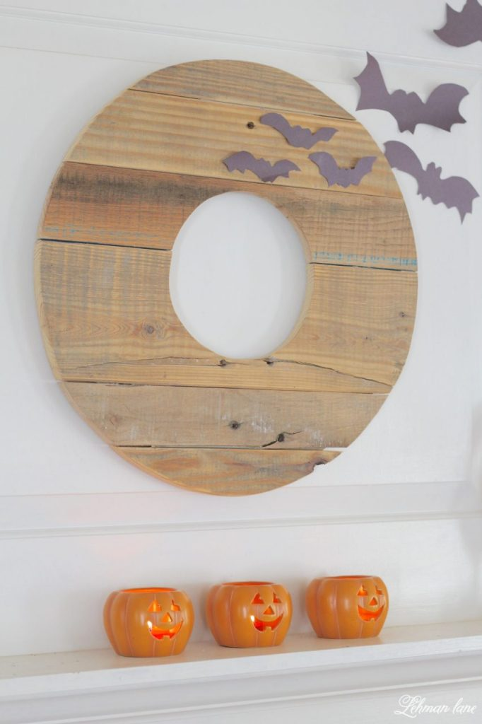 Halloween Mantel - pallet wreath, paper bats and pumpkin candles