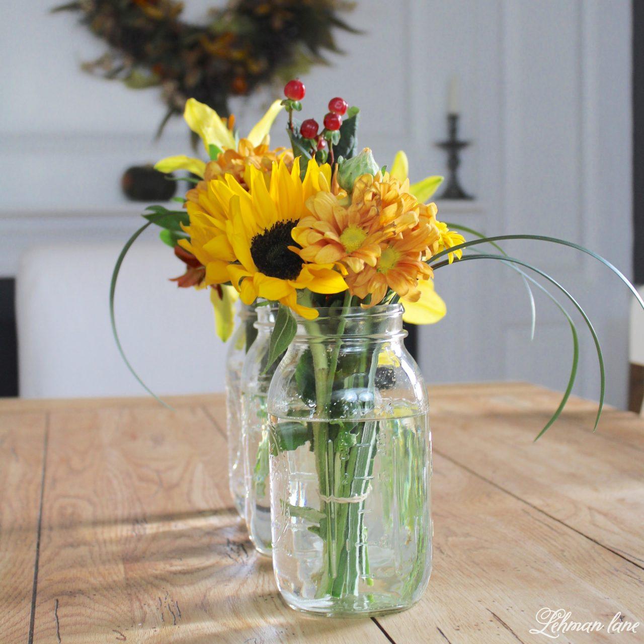 Simple Flower Arrangement - Farmhouse table with mason jar floral arrangements, #flowerarranging #fallflowers #falltablescape http://lehmanlane.net