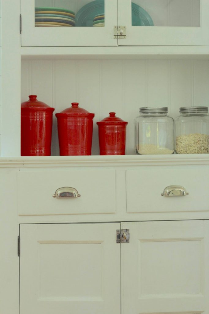 """Vintage Farmhouse kitchen hutch -  I have long been on the hunt for the perfect kitchen hutch for our farmhouse kitchen! I should have listened to Jason when he tried to tell me how much work refinishing this piece would be. My """"perfect"""" kitchen hutch needed more than just a paint job, it needed to be completely MAKEOVER! #farmhousekitchen #paintedfurniture https://lehmanlane.net"""