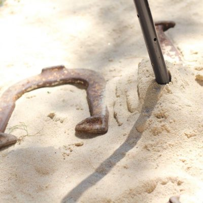 DIY - How to Build a Horseshoe Pit - Today I am sharing all about how to build a Horseshoe pit for your backyard. It was super simple to make, inexpensive, and our whole family loves to play it. #diy #horseshoepit http://lehmanlane.net
