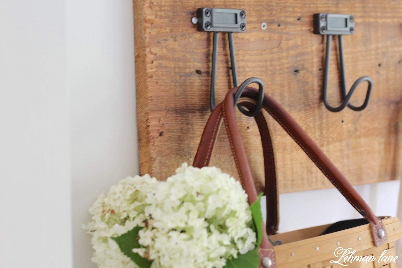 Farmhouse DIY Towel Rack - I created this beautiful, heavy duty and inexpensive DIY towel rack for our farmhouse kitchen.  Sharing my simple step by step instructions for how to make a towel rack of your own to hang coats, aprons, bags, baskets and towels! #towelrack #diy #upcycle http://lehmanlane.net