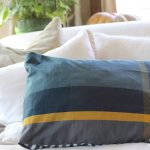 DIY Pillow Cover - With no chance of finding the matching pillow I was looking for I decided to make one of my own.My new pillow was created using 2 dish towels with the same pattern making it the simplest DIY pillow cover EVER for just $6 in just 5 mins! #diypillow #pillow http://lehmanlane.net