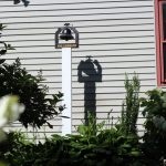 DIY Antique Bell for our Farmhouse - I have been on the hunt for an antique bell to add to the front of our farmhouse for years now. We recently added one to our front garden walkway & I love the character & personality it brings to the front of our farmhouse. #antiquebell http://lehmanlane.net