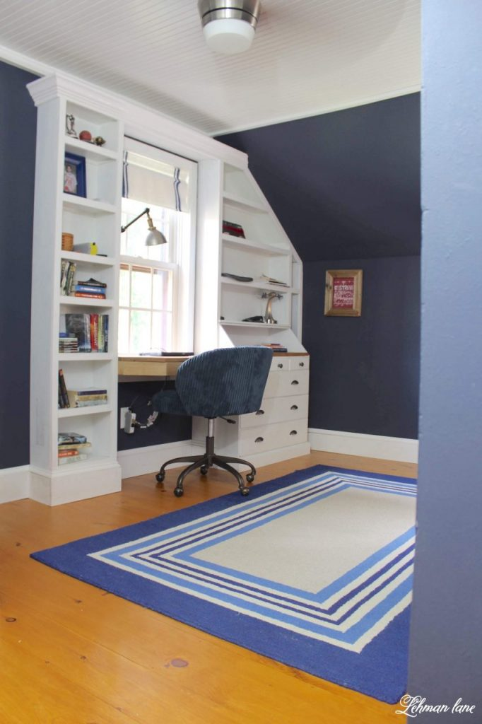 Sharing all the tips & tricks of this awesome built in boys dark blue bedroom renovation & reveal with more than 8 DIY project ideas included like new pine floors, bead board ceiling, built in bed, bookcase, drawers, desk, angled door & storage ideas to increase floor space in a narrow bedroom with pictures! #builtindesk #boysbedroomideas https://lehmanlane.net