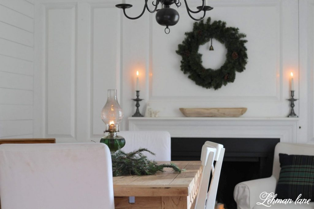 Christmas Dining Room - simple, beautiful & FREE Christmas decor with evergreens & candlelight  for our farmhouse dining room #christmas #farmhousechristmas https://lehmanlane.net