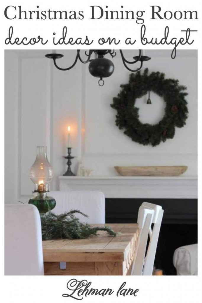 Sharing all the details of our Farmhouse Christmas Dining Room Decor Ideas & how we decorate our white dining room for Christmas with greenery, candlelight & pictures on a budget. #christmas #farmhousedecor https://lehmanlane.net