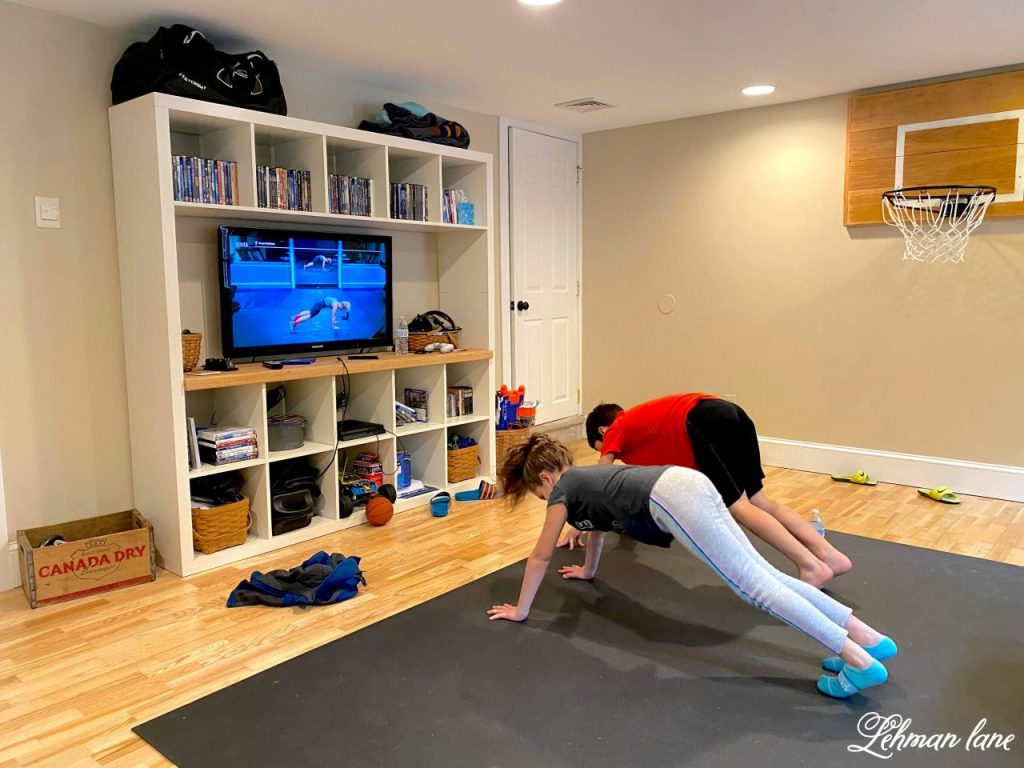 DIY Home Gym Exercise Room & Office -We transformed our basement into a home gym/ exercise room & office. This is a simple & inexpensive DIY project for the basement of our farmhouse.#homegym #exerciseroom #diy https://lehmanlane.net