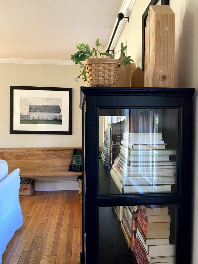 Sharing all the details of our gorgeous new living room bookcase, the Ikea Malsjo Glass Door Cabinet including a review with pictures. #bookcase #farmhouse #homedecor https://lehmanlane.net