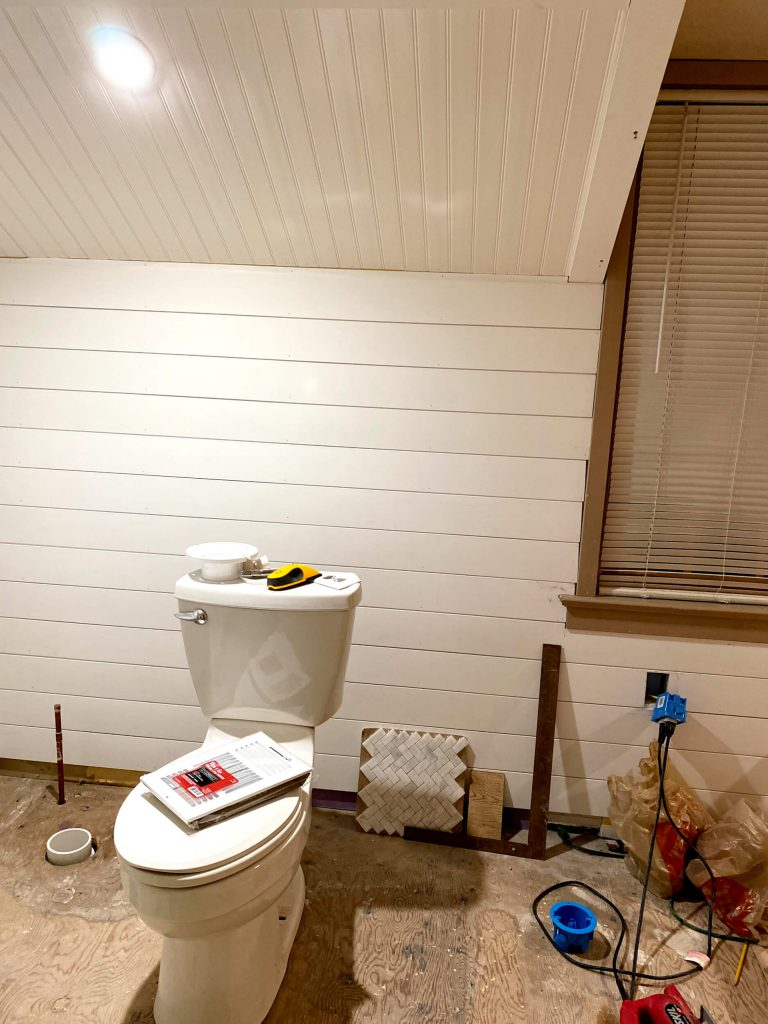 Sharing all the details of how we added a beautiful white bead board ceiling and shiplap in the master bath with pictures. #masterbathroom #diyprojects https://lehmanalne.net
