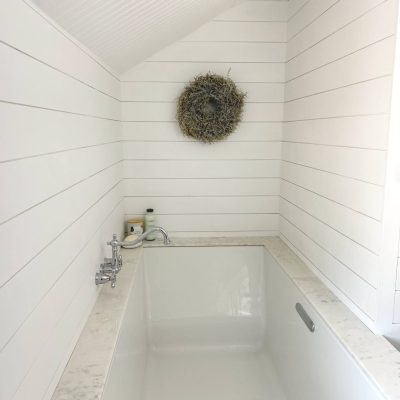 Sharing all the details of our new GORGEOUSLY deep soaking undermount DIY Kohler Underscore Bathtub in our Farmhouse Master Bathroom Remodel with step by step pictures & a review about what surprised us about the tub. #bathtub #masterbathroom https://lehmalane.net
