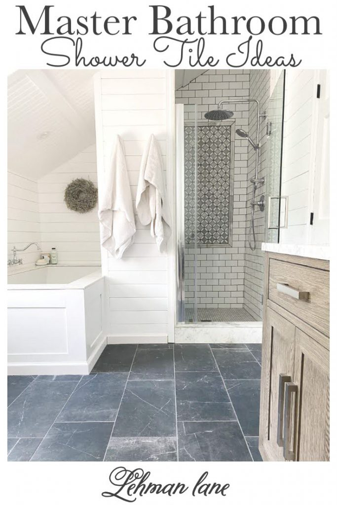Sharing all the tips & tricks we used to create an elegant luxury master bathroom with the best master bathroom shower tile & floor combination ideas using Carrara marble, white subway tile with a marble accent wall & large Black veined marble look floor tile with grey grout & pictures! #farmhousebathroom #showertile #marbletile
