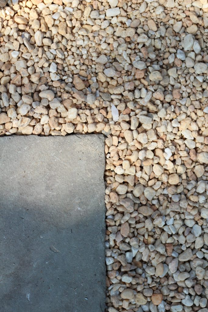 Sharing all the details of how to build an inexpensive & awesome DIY pea gravel patio for the backyard with easy DIY ideas tips & step by step before & after photos. #flagstone #peagravelpatio #hardscaping https://lehmanlane.net