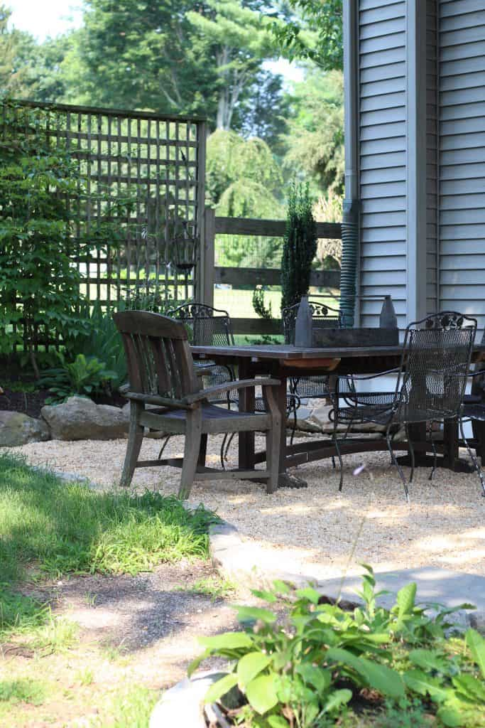 Sharing all the details of how to build an inexpensive & awesome DIY pea gravel patio for the backyard with easy DIY ideas tips & step by step before #peagravelpatio https://lehmanlane.net & after photos.