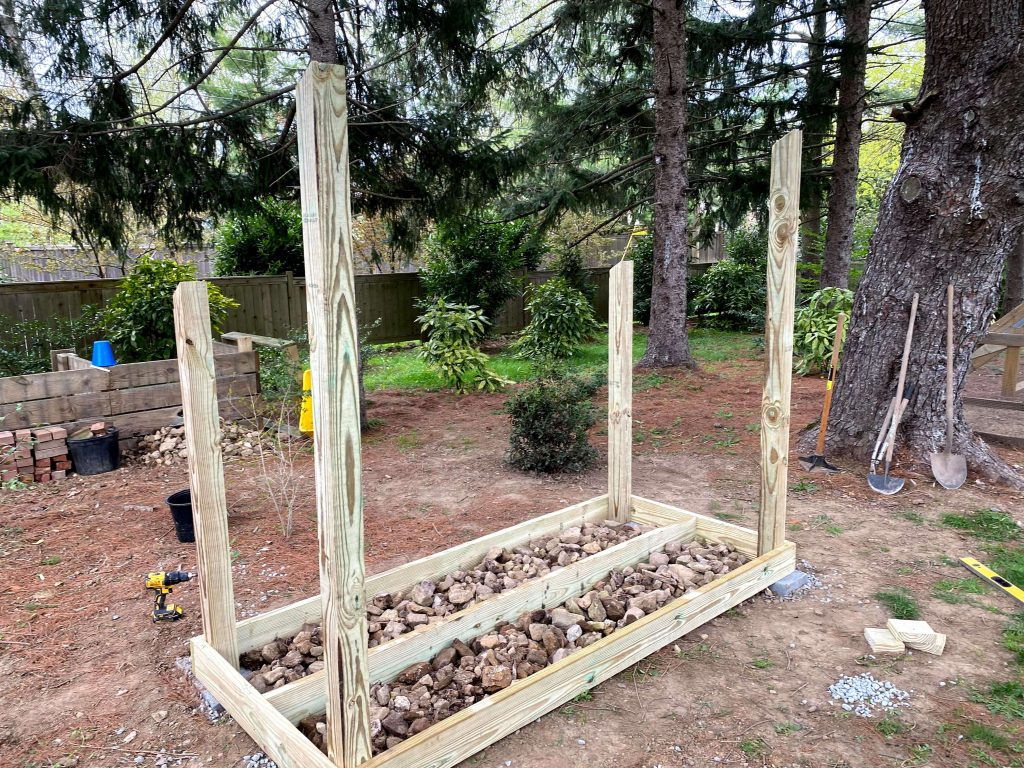 Sharing all our tips & tricks for building a large DIY outdoor wood firewood storage shed on a budget that looks nice in the backyard with step by step instructions for How to build a firewood storage shed for wood log storage with pictures! #firewoodstorage #storageshed https://lehmanlane.net